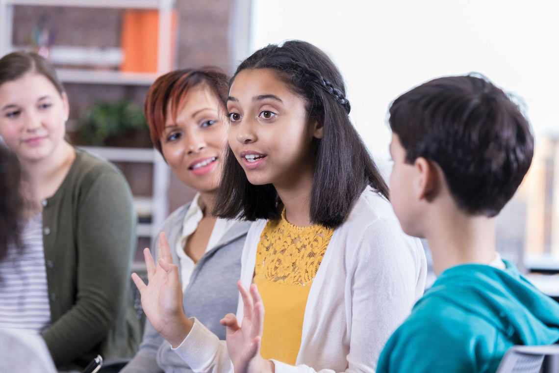 teenage girl talks in group therapy session