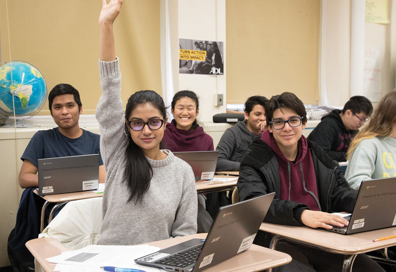 classroom high school students hand raised